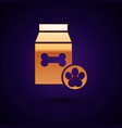 gold bag food for pet icon isolated on dark vector image vector image