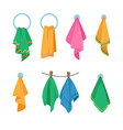 set icons towels hanging on hook ring and rope vector image