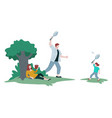 family in park father and son playing badminton vector image vector image