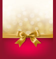 golden bow on red background with light bokeh vector image