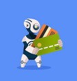 robot holding credit cards on blue background vector image