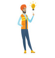 young hindu builder pointing at light bulb vector image vector image