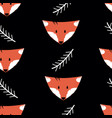 seamless pattern with foxes and twigs on a black vector image