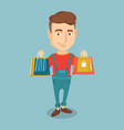 happy man holding shopping bags vector image vector image