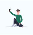 man taking selfie photo on smartphone camera vector image vector image