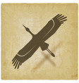 silhouette flying stork on vintage background vector image vector image