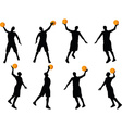 basketball player slhouette in slam pose vector image vector image