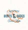 bespoke boots and shoes retro sign symbol vector image