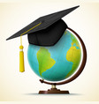 realistic graduation cap hang on the globe vector image