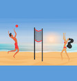 young couple playing beach volleyball at sunset vector image
