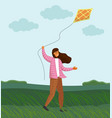 girl playing with kite in windy weather on green vector image