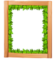 A border design made of wood and green leaves vector image vector image