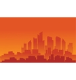 Silhouette of building with orange background vector image