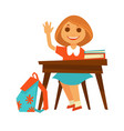 cheerful little girl sits at desk in school vector image