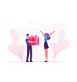 loving boyfriend presenting huge wrapped gift box vector image vector image