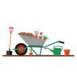 formal garden with wheelbarrow flowers shovel vector image vector image
