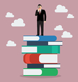 Businessman standing on stack of books with a vector image vector image
