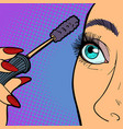 woman paints eyelashes makeup vector image vector image