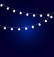 christmas fairy light bulbs on a blue background vector image