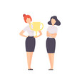 successful businesswoman standing with winner cup vector image vector image