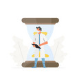 doctor stands in front a large hourglass vector image
