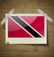 Flags Trinidad and Toba at frame on wooden texture vector image