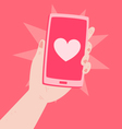 Hand Holding a Phone with a Heart Inside vector image vector image