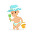 cute bain a diaper playing with toy bucket and vector image