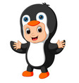 cute boy cartoon wearing penguin costume vector image vector image