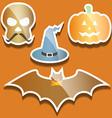 Flat scull pumpkin hat and bat vector image vector image