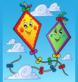 two flying kites on blue sky vector image