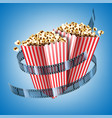 movie theater flyer with film strip and popcorn vector image