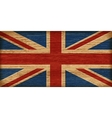 UK flag on old wooden texture vector image