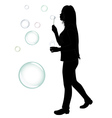 blowing bubbles silhouette vector image vector image