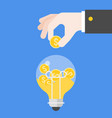 hand inserting coins in light bulb flat design vector image vector image