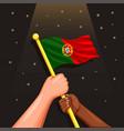 portugal flag on hand symbol for celebration vector image vector image