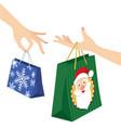 woman hand holding christmas shopping bag vector image