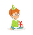 adorable baby boy wearing a green party hat vector image vector image