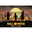 halloween kids in front graveyard cemetery gate vector image vector image