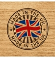 Made in the UK Stamp on wooden background vector image