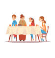 Happy family sitting at kitchen table drinking