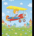 little pilot in his plane over a town vector image vector image