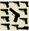A set of silhouettes of pistols vector image