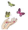 female hands with flying colorful butterflies vector image vector image