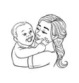 young mother holding in arms and kissing her vector image vector image