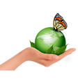 Green world with leaf and butterfly in woman hand vector image
