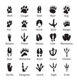 Wild animals traces black icon set with names