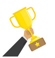 gold cup in hand vector image