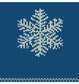 Knitted pattern with snowflake vector image
