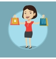 Happy woman holding shopping bags vector image vector image